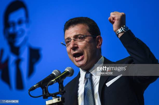 Turkish opposition candidate for the Istanbul re-run for the mayor's election, Ekrem Imamoglu gestures as he delivers a speech on stage during his...