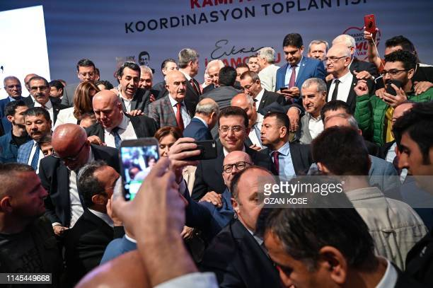 Turkish opposition candidate for the Istanbul rerun for the mayor's election Ekrem Imamoglu poses for selfiepictures with party members during his...