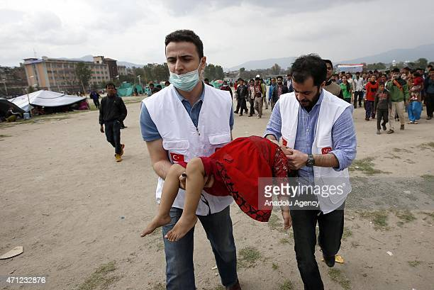 Turkish paramedics treat a fainted child at a tent camp site in Katmandu, Nepal on April 26, 2015. The death toll in Nepal climbed towards 2,500 on...
