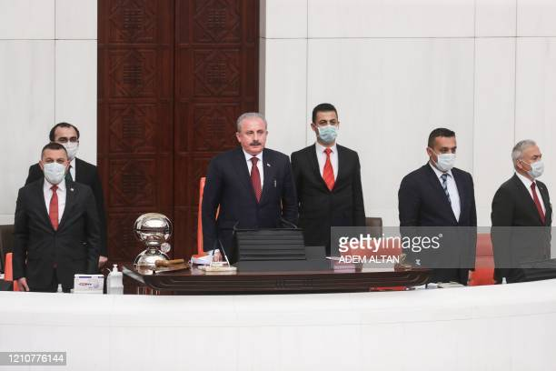 Turkish Parliament Speaker Mustafa Sentop speaks as other members wear a protective facemask as a preventive measure against the spread of the...
