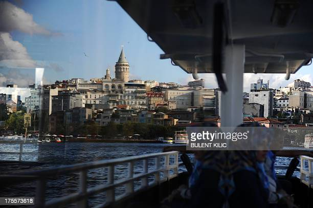Turkish passengers travel by ferry on the Bosphorus on August 4 2013 in Istanbul as the city swelters under a heat wave AFP PHOTO/BULENT KILIC