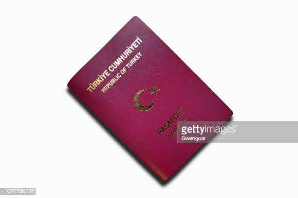turkish passport isolated on a white background - gwengoat stock pictures, royalty-free photos & images