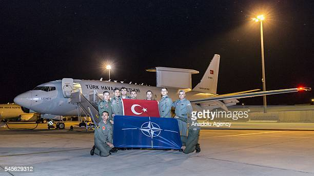 Turkish 'Peace Eagle' team are seen in the Boeing 737 AEWC of Turkish Air Force early warning and control aircraft after completing its mission in...