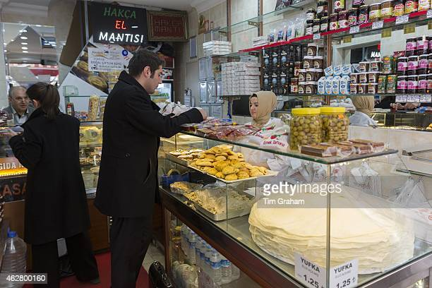Turkish people shopping for food at food market in Kadikoy district on Asian side of Istanbul East Turkey