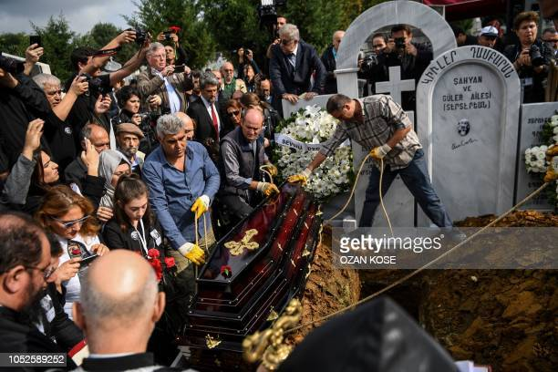Turkish photographer Ara Guler's coffin is about to be deposited in the grave at the Sisli Armenian cemetery during his funeral at Sisli district in...
