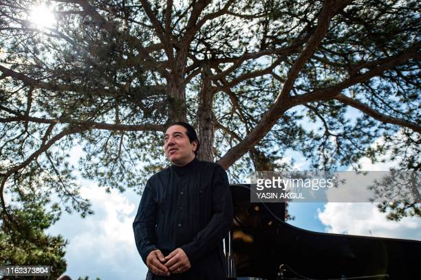 Turkish pianist and composer Fazil Say acknowledges the audience at a concert against deforestation on the site of a controversial goldmine project...