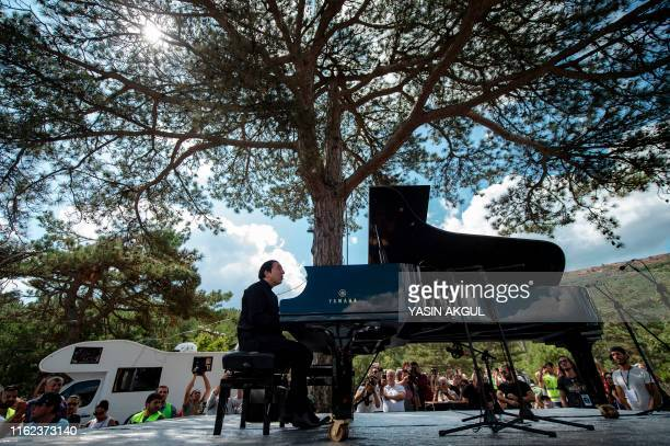 Turkish pianist and composer Fazil Say gives a concert against deforestation near the town of Kirazli in Turkey's Canakkale province in northwestern...