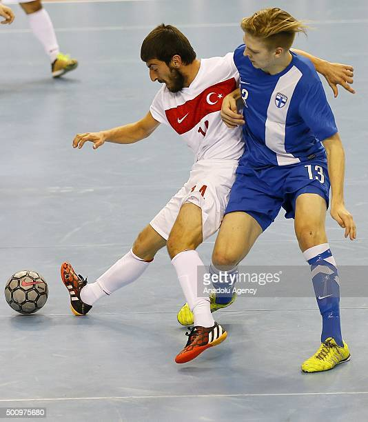 Turkish player Bilgehan Demiral vies against Finnish player Jani Korpela during the Futsal World Cup 2016 qualifying match between Turkey and Finland...