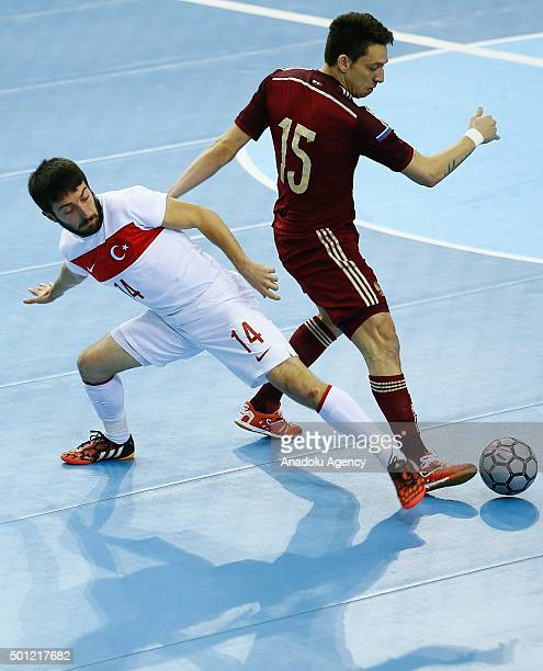 Turkish player Bilgehan Demiral vies against Russian player Romulo during the Futsal World Cup 2016 qualifying match between Turkey and Russia at...
