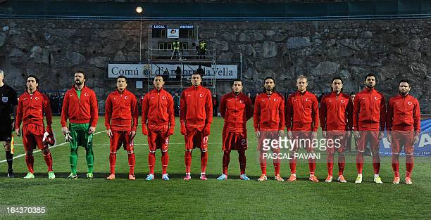 Turkish player stand before a World Cup 2014 European qualifying Group D football match against Andora on March 22 2013 at the Municipal Stadium in...