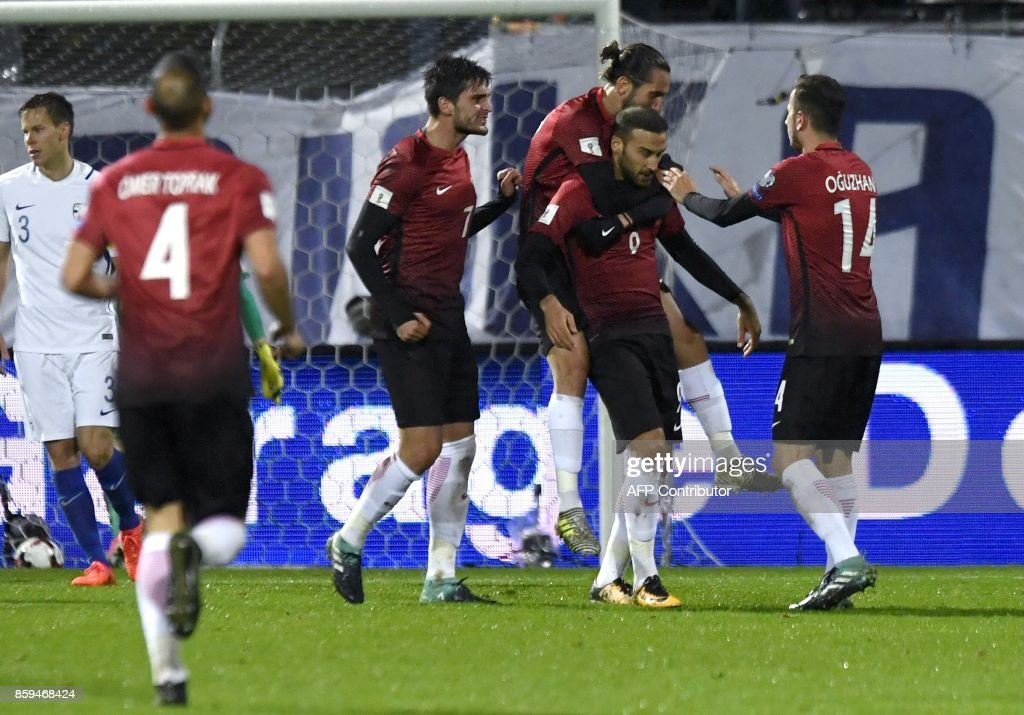 Turkish players celebrate the first goal scored by Cenk Tosun (2nd R) during the FIFA World Cup 2018 qualifying football match between Finland and Turkey in Turku, Southern Finland on October 9, 2017. / AFP PHOTO / Lehtikuva / Antti Aimo-Koivisto / Finland OUT