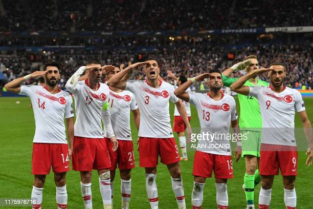 TOPSHOT Turkish players salute at the end of the Euro 2020 Group H qualification football match between France and Turkey at the Stade de France in...