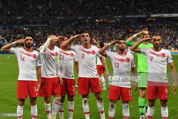 Turkish players salute at the end of the Euro 2020 Group H qualification football match between France and Turkey at the Stade de France in...