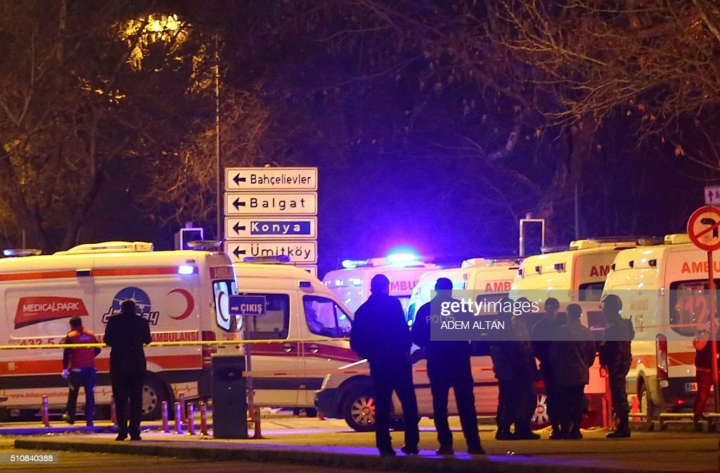 Turkish police and ambulance cars are seen near the site of an explosion after an attack targeted a convoy of military service vehicles in Ankara on February 17, 2016. At least 28 people were killed and 61 people were wounded in a car bombing targeting military service vehicles in the Turkish capital Ankara on February 17, Deputy Prime Minister Numan Kurtulmus told reporters. Kurtulmus condemned the attack and vowed to 'shed all light' on the bombing, but said there was no indication yet who may have carried it out. The toll substantially raised the previous toll of 18 dead. ALTAN