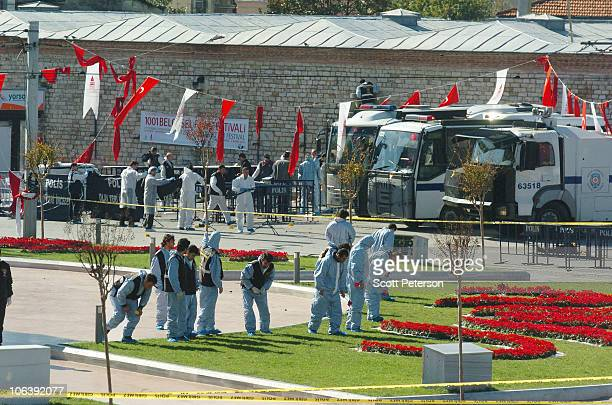 Turkish police and forensic units search for evidence in Taksim Square in the aftermath of a suicide attack which injured 22 including 10 policemen...