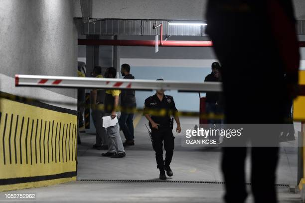 Turkish police are seen in the cordoned off underground car park, on October 22, 2018 in Istanbul, after they found an abandoned car belonging to the...