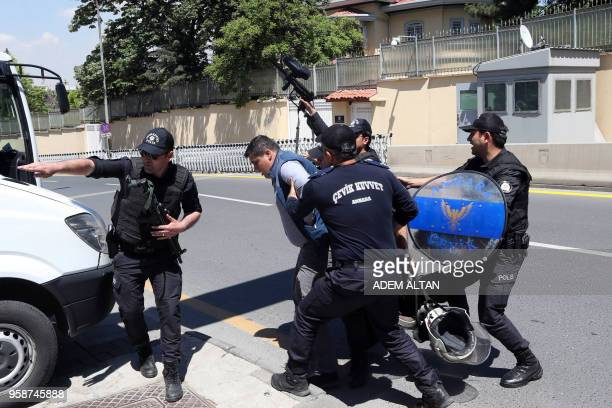 Turkish police arrest a man who was throwing eggs and stones at the residence of the Israeli Ambassador in Ankara on May 15 2018 during a...