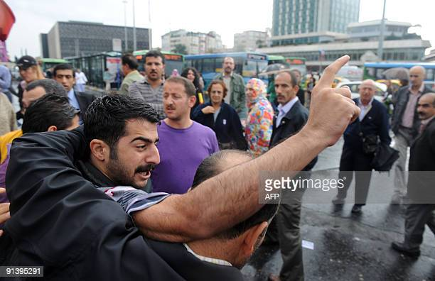 Turkish police arrest a protestor during an antiInternational Monetary Fund and World Bank protest in central Istanbul on October 4 2009 Members of...