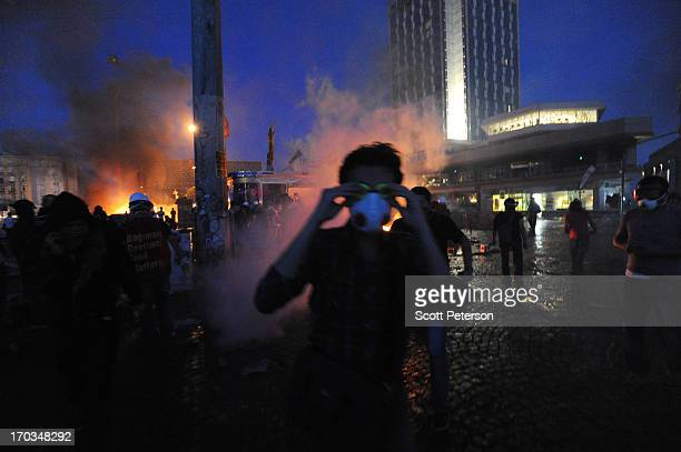 Turkish police battle antigovernment protestors to reestablish police control of Taksim Square after an absence of 10 days on June 11 2013 in...