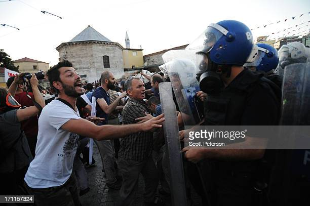 Turkish police clash with anti-government protestors while they clear Taksim Square and push them down the Istikhlal shopping avenue on June 22, 2013...