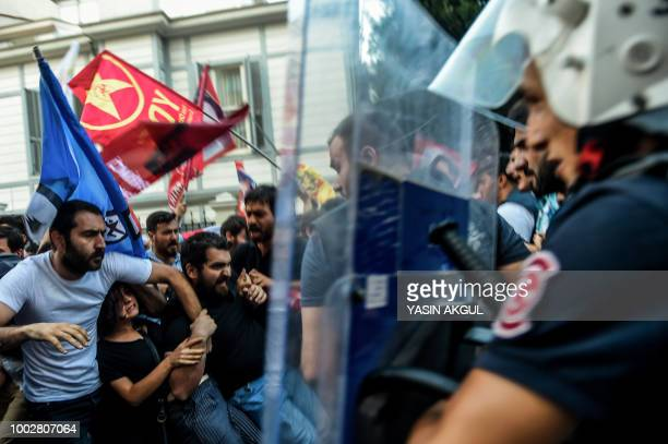 Turkish police confront demonstrators on July 20 in the Kadikoy district of Istanbul, during the anniversary of the 2015 suicide attack in the...