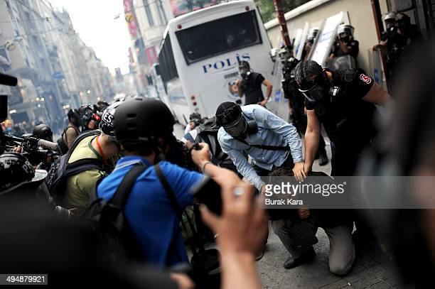 Turkish police detain a demonstrator during a protest in central Istanbul on May 31 2014 Turkish police fired teargas and water cannon on Saturday to...