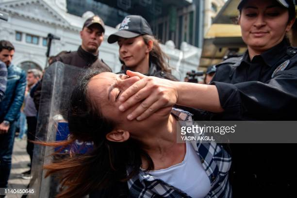 Turkish police detain a protester attempting to defy a ban and march on Taksim Square to mark May Day on May 1 in Istanbul Multiple areas of Istanbul...