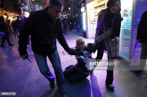 Turkish police detain a protester during a demonstration in support of a teacher and an academic on a hunger strike to protest their sacking on...