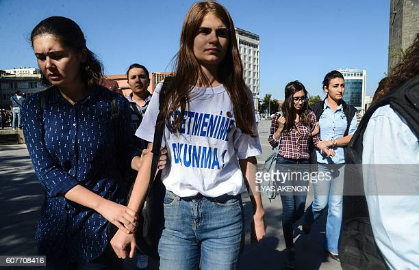 TOPSHOT Turkish police detain a student wearing a tshirt reading 'Don't touch my teacher' in Diyarbakir on September 19 during a protest against the...