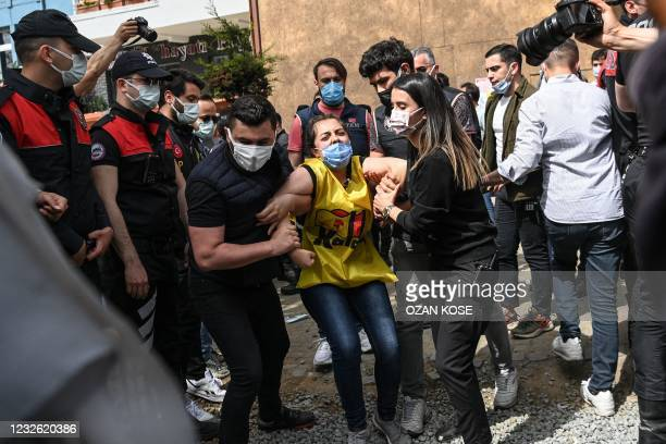Turkish police detains a demonstrator as they clash during a May Day rally marking the international day of the worker in Besiktas, a district of...