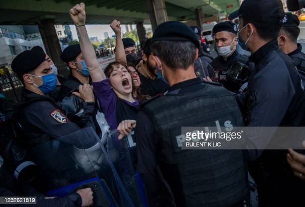 Turkish police detains demonstrators as they clash during a May Day rally marking the international day of the worker in Istanbul, on May 1, 2021. -...