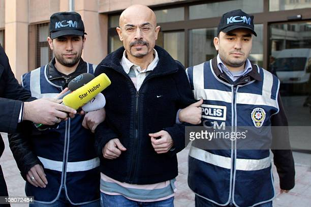 Turkish police escort doctor Yusuf Sonmez to a local court in Istanbul on January 12 2011 Sonmez was apprehended on January 12 in a raid on a luxury...