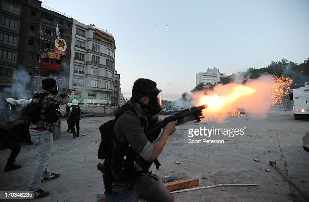 Turkish police firing tear gas battle antigovernment protestors as they try to reestablish police control of Taksim Square after an absence of 10...