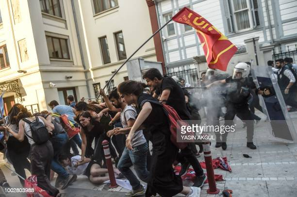 Turkish police hold back demonstrators on July 20 in the Kadikoy district of Istanbul, during the anniversary of the 2015 suicide attack in the...