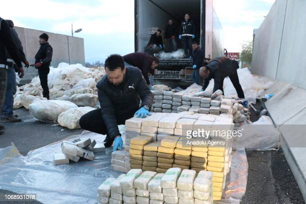 Turkish police inspect heroin packages after antidrug squads stopped a longrig trailer truck en route from Istanbul to the eastern Van province and...