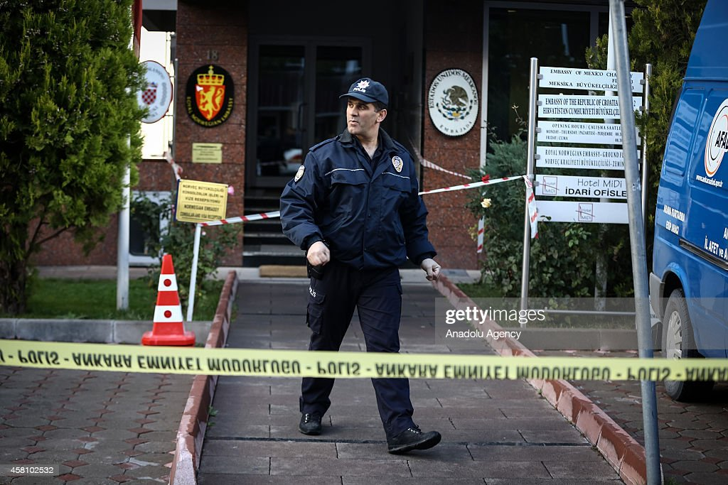 A Turkish police is seen outside the building of embassies of Mexico, Croatia and Norwegian where Disaster and Emergency Management Presidency of Turkey (AFAD) and Turkish National Medical Rescue (UMKE) team members investigate the building due to a suspicious letter containing unknown thing sent to the Norwegian embassy in Ankara, Turkey on October 30, 2014.