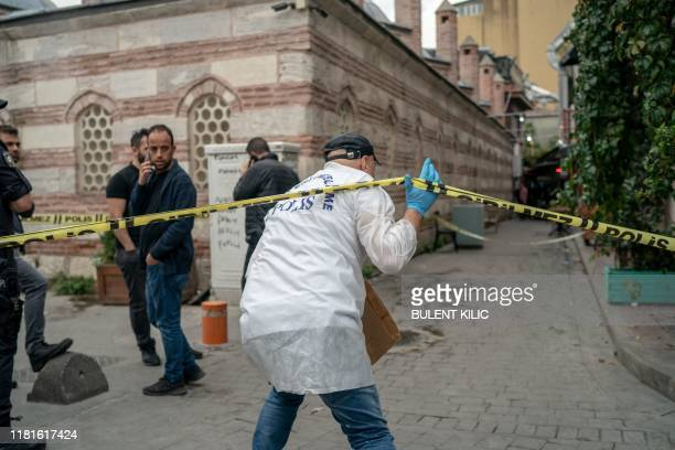 A Turkish police officer arrives at the scene of the Mayday Rescue offices on November 11 in the Karakoy district of Istanbul following the discovery...