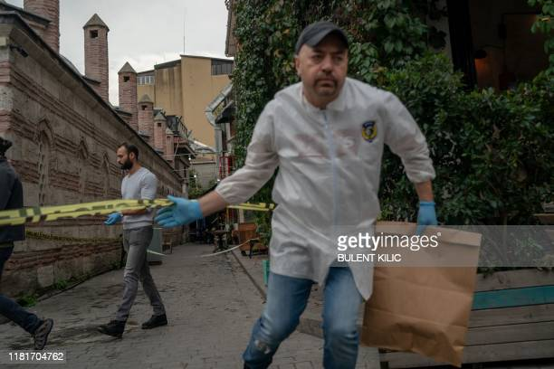 A Turkish police officer leaves the scene of the Mayday Rescue offices on November 11 in the Karakoy district of Istanbul following the discovery of...