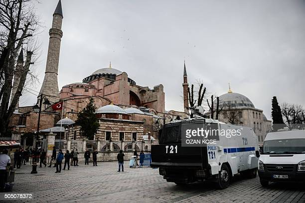 Turkish police officer stand guard on January 15 2016 near the makeshift memorial in tribute to the victims of January 12 deadly attack at the...