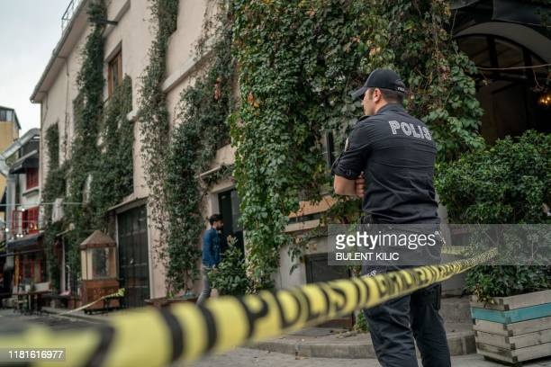 A Turkish police officer stands guard ouside the Mayday Rescue offices on November 11 in the Karakoy district of Istanbul following the discovery of...