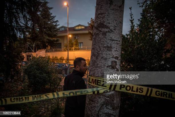 Turkish police officer stands watch after sealing off an area in front of the Saudi Arabian consulate amid a growing international backlash to the...