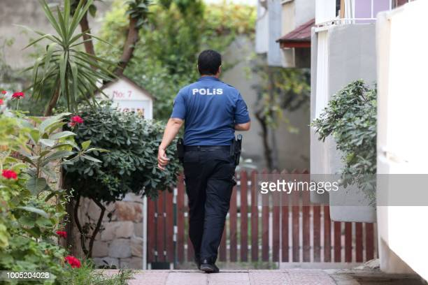 A Turkish police officer walks near the house of US Pastor Andrew Craig Brunson prior to his arrival at his house on July 25 2018 in Izmir Turkey on...