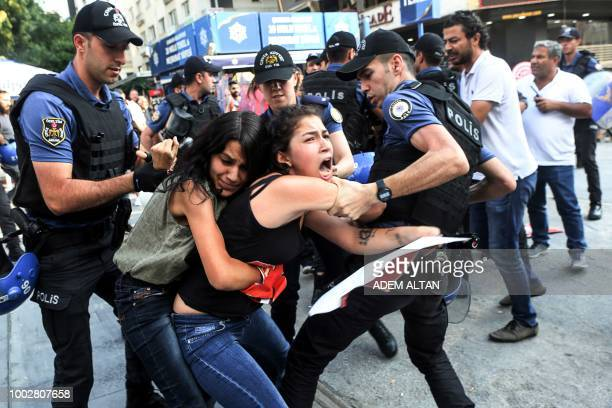 Turkish police officers arrest demonstrators, in Ankara, on July 20, 2018 as they were taking part in a protest rally for the anniversary of the 2015...