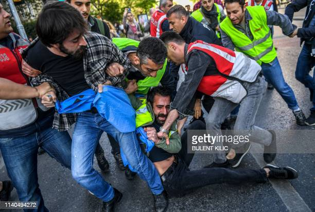 Turkish police officers arrest protesters attempting to defy a ban and march on Taksim Square to mark May Day on May 1 in Istanbul Multiple areas of...