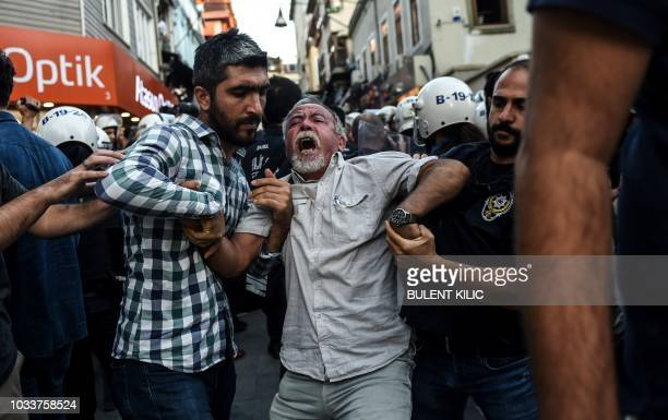 TOPSHOT Turkish police officers arrest protesters gathered in support of workers that were arrested earlier for protesting over labour conditions at...