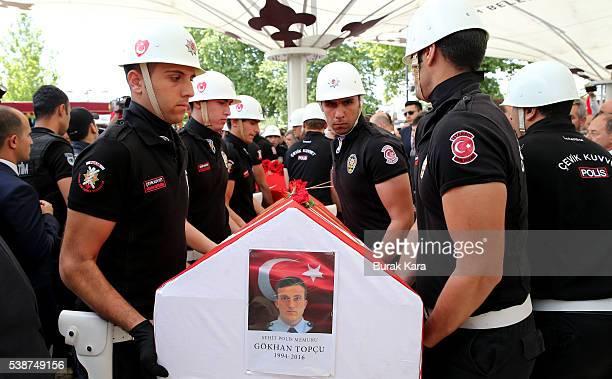 Turkish police officers carry the coffin of a policeman Gokhan Topcu and Kadir Cihan Karagozlu who were among seven Turkish police officers killed...
