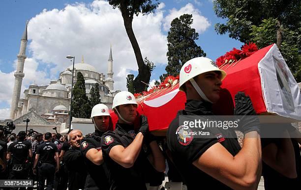 Turkish police officers carry the coffin of policeman Kadir Cihan Karagozlu who was among seven Turkish police officers killed the day before in a...