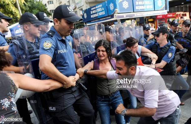 Turkish police officers clash with demonstrators, in Ankara, on July 20, 2018 as they were taking part in a protest rally for the anniversary of the...