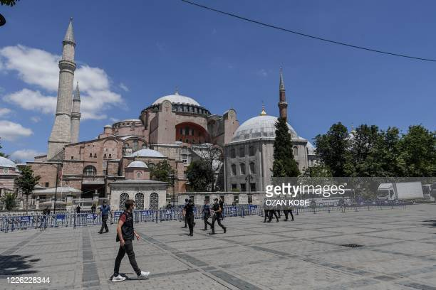 Turkish police officers patrol in front of Hagia Sophia on July 11, 2020 in Istanbul, a day after a top Turkish court revoked the sixth-century Hagia...