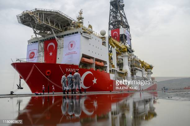 Turkish police officers patrols next to the drilling ship 'Yavuz' scheduled to search for oil and gas off Cyprus, at the port of Dilovasi, outside...